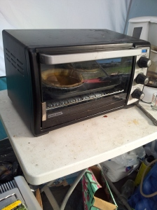 This thing can heat like a convection oven! See the tiny pies inside? Yum!